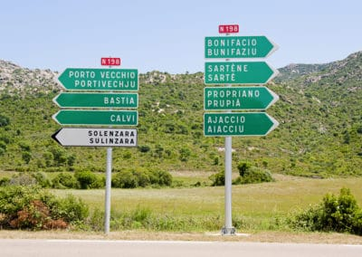 Directional signs to main cities in Corsica, France